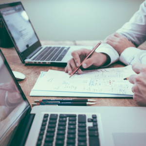 Image of money and accountancy. Direct Business & Accounting Services discuss how an accountant can help a business to grow, including business accounting services such as tax returns, sourcing funding and securing a business' financial future.