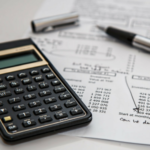 Images representing a blog by Direct Business & Accounting Services in Burnley, Lancashire, discussing top tips for keeping the finances of a small business in order, including staying organised, record keeping, and invoice records.